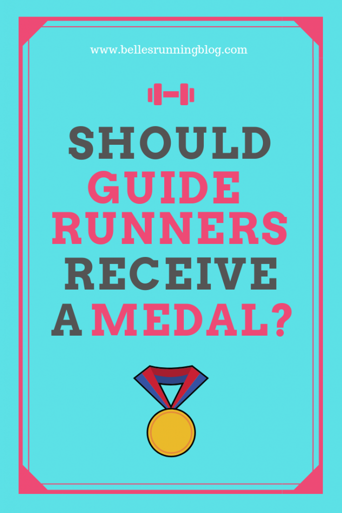 should guide runners receive a medal at the VLM | blind runners